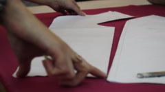 Worker prepares pattern for cutting fabric 5 Stock Footage