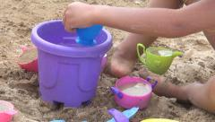 Child, Little Girl Playing with Toys in Sand by Beach Waves, Coastline, Sea Stock Footage