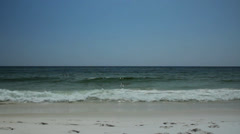 Emerald ocean and beach wide shot Stock Footage