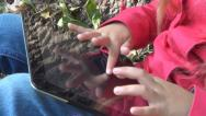 Stock Video Footage of Child Playing at Tablet Device in Park, Girl Using Touchscreen Ipad, Children
