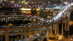 Slow moving cars on overpass interchange,Brightly lit urban building,shanghai. Stock Footage
