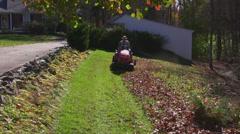 Man mows lawn 3 Stock Footage