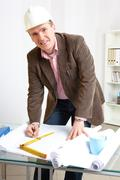 Architect working in office Stock Photos