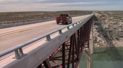 Pick-up Truck Crosses Pecos River Bridge - Texas US 90 Stock Footage