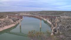 Transport Truck Crosses Pecos River Bridge - Texas Stock Footage