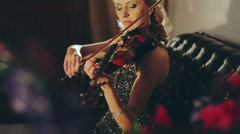 Woman in evening dress playing the violin - stock footage