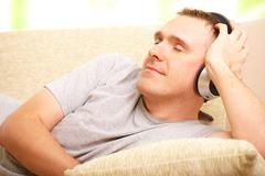 man listening music with headphones - stock photo