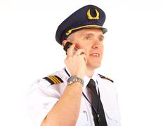 Airline pilot on the phone Stock Photos