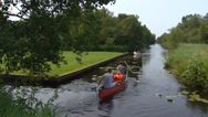 Stock Video Footage of Canoeing through canal, peat bog landscape Weerribben-Wieden National Park