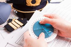 airplane pilot filling in flight plan - stock photo