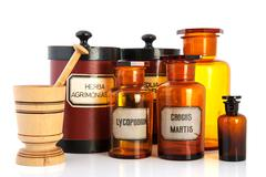 Apothecary pots with ingredients for medicins Stock Photos