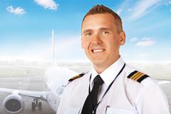 airline pilot at the airport - stock photo