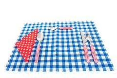 Cutlery and table cloth Stock Photos