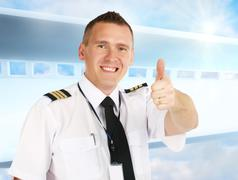 Airline pilot thumb up Stock Photos