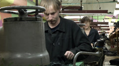 Shoe shop, working on the machines perform the operation Stock Footage