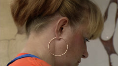 Redhead worker pierced profile during operation Stock Footage