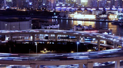 Time lapse,the light trails of urban traffic on overpass,shipping on river. Stock Footage