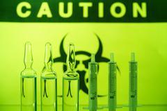biohazard and ampules - stock photo