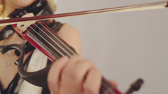 Color detail withhands of a person playing the violin Stock Footage