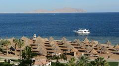 The motor yacht near beach at the luxury hotel, Sharm el Sheikh, Egypt Stock Footage