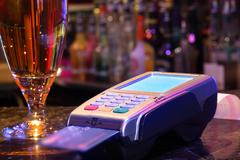 Paying drink with credit card Stock Photos