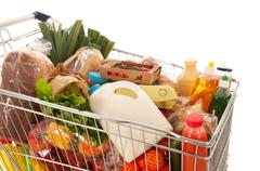 Shopping cart full dairy grocery Stock Photos