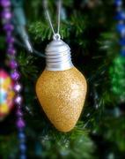 Yellow light bulb Stock Photos