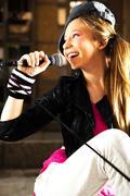 Modern hip - hop girl with mic Stock Photos