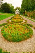 Gazebo and walk way in an english formal garden Stock Photos