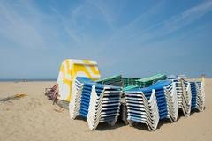 Stacked empty beds at the beach Stock Photos