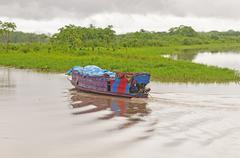 local ferry boat in the amazon river - stock photo