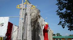 On hangers swings crocheted linen ladies blouses  fair market Stock Footage