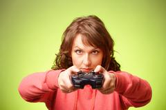 Beautiful womanl with gamepad playing vieogame Stock Photos