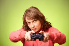 beautiful womanl with gamepad playing vieogame - stock photo