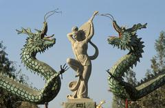 China, Beijing, colorful dragons and statue - stock photo