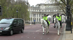 Mounted Police on the Mall with Admiralty Arch behind, London, UK. Stock Footage