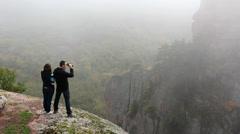 Tourists admiring Belogradchik valley through binocular Stock Footage