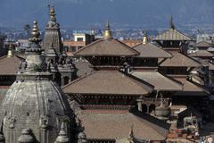 Stock Photo of Nepal, Patan. Durbar square and temple roofs