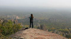 Tourist admiring panorama at Belogradchik rocks Stock Footage