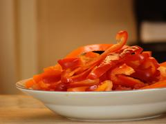 Stock Photo of Cut red and orange peppers
