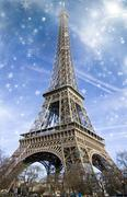 view of eiffel tower at night - stock illustration