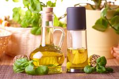 two bottles with olive oil and grape seed oil - stock photo