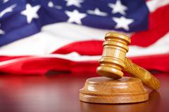 Stock Photo of judges gavel with flag