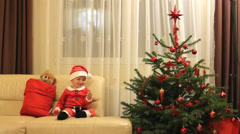 Amusing  Santa Claus play with Christmas ornaments hear shape, gift bag, tree Stock Footage