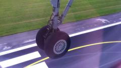 Landing: the airplane goes to airfield, undercarriage close-up Stock Footage