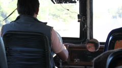 Man driving a bus on a bumpy and dirt road in Argentina Stock Footage