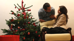 Relaxed lady and man, have fun near decorated fire tree, talk, smile, laugh  Stock Footage