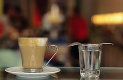 Cappuccino in glass Stock Photos