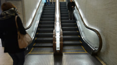 People on escalator, underground Shinjuku, Tokyo Stock Footage