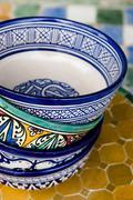 Hand made cups at Poterie de Fes 32 Ain Nokbi Route Sidi Harazem-Fes, Morocco - stock photo